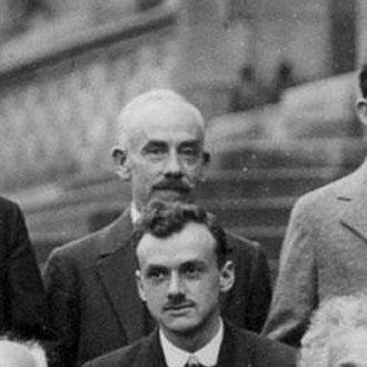 Théophile de Donder - Théophile Ernest de Donder (1872 – 1957) at the 1927 Solvay Conference. Appearing in front of de Donder is Paul Dirac.