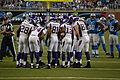 The Minnesota Vikings offense in a huddle.jpg