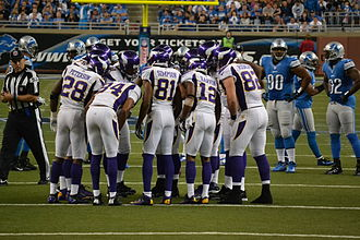 Huddle - The Minnesota Vikings offense in a huddle, September 2012