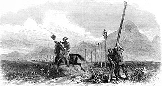 First transcontinental telegraph - Wood engraving depiction of the construction of the first transcontinental telegraph, with a Pony Express rider passing below.