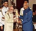 The President, Shri Ram Nath Kovind presenting the Padma Bhushan Award to Shri Laxman Pai, at the Civil Investiture Ceremony-II, at Rashtrapati Bhavan, in New Delhi on April 02, 2018.jpg