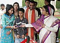 """The President, Smt. Pratibha Devisingh Patil receiving greetings from all walks of life and distributing chocolates to students, on the occasion of """"Diwali"""", at Rashtrapati Bhavan, in New Delhi on November 05, 2010.jpg"""
