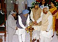 The Prime Minister, Dr. Manmohan Singh lighting the lamp at the inauguration of the Parliament Museum, in New Delhi on August 14, 2006.jpg
