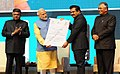 The Prime Minister, Shri Narendra Modi awards the District Collectors who transformed the most backward districts to adopt digital payments, at the DigiDhan Mela, in New Delhi (2).jpg