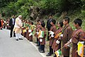 The Prime Minister, Shri Narendra Modi meeting children who lined up waving flags to wish him goodbye along the road to the airport, in Thimphu, Bhutan on June 16, 2014.jpg