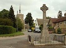 The War Memorial and parish church at Hinxton - geograph.org.uk - 456879.jpg
