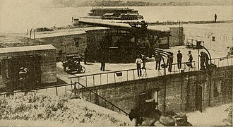 Fort Hamilton - 12-inch disappearing gun at Fort Hamilton with Fort Lafayette in the background.