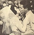 Tommy Sands kissed his bride Nancy Sinatra, 1960.jpg