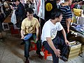 Two Booth Sellers Sitting on Stools 20140705.jpg