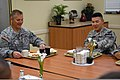 U.S. Army Col. Steve Gilland, left, commander of the 1st Brigade Combat Team, 1st Cavalry Division, dines with junior Soldiers of the 2nd Battalion, 5th Cavalry Regiment during breakfast 130321-A-EO505-077.jpg