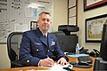 U.S. Coast Guard Chief Petty Officer Jerry Tucker, the clinic supervisor at Coast Guard Base Portsmouth, Va., poses for a photo his service dress blue uniform April 3, 2013 130403-G-RU719-007.jpg