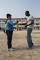 U.S. Marine Corps Lance Cpl. Justin Brown, right, a legal clerk with the III Marine Expeditionary Force Headquarters Group, teaches a South Korean elementary school student how to dance March 27, 2014, while 140327-M-UQ794-189.jpg