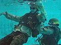 U.S. Marines practice water survival training in a swimming pool while in full battle dress at Combat Water Survival Swimming School in Camp Johnson, N.C., July 22, 2005 050722-M-FQ358-002.jpg