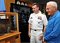 U.S. Navy Capt. Douglas Peabody, left, the commanding officer of the U.S. Pacific Command Joint Intelligence Operations Center, and Ewalt Shatz, a survivor of the attack on Pearl Harbor, view a display 131206-N-QN361-025.jpg