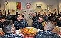 U.S. Navy Rear Adm. Dee L. Mewbourne, the new commander of Naval Service Training Command, talks to recruits during a pre-graduation pizza night in the USS Hopper recruit barracks galley at Recruit Training 121228-N-IK959-489.jpg