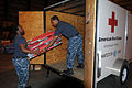 U.S. Navy Ship's Serviceman 3rd Class Darius Hill and Logistics Specialist 2nd Class Andy Adon, both assigned to the command headquarters at Naval Air Station Pensacola, Fla., load a Red Cross trailer with 120827-N-EJ993-001.jpg