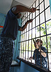 U.S. Sailors embarked aboard the amphibious assault ship USS Iwo Jima (LHD-7), scrape rust off a school window in Limon, Costa Rica, Aug. 23, 2010, during Continuing Promise 2010 100823-M-PC721-266.jpg