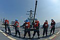 U.S. Sailors heave a line aboard the guided missile destroyer USS McCampbell (DDG 85) during a replenishment at sea with the fleet replenishment oiler USNS Pecos (T-AO 197), left, in the Pacific Ocean March 5 130305-N-TG831-107.jpg