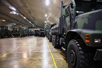 Marine Corps Prepositioning Program-Norway - United States Marine Corps front loaders and 7-ton trucks in the Frigard supply cave during 2012