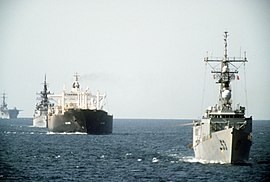 USS Hawes (FFG-53), USS William H. Standley (CG-32) and USS Guadalcanal (LPH-7) escort tanker Gas King in the Persian Gullf on 21 October 1987 (6432283).jpg
