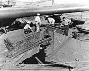 USS Nevada damage to forecastle deck due to bomb blast'