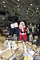 US Navy 021224-N-4142G-003 Santa Claus helps pass out mail that has just arrived.jpg