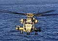 US Navy 030128-N-5027S-001 A CH-53E flies over the Atlantic Ocean at sunrise during Deck Landing Qualification's.jpg