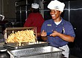 US Navy 030520-N-8102J-001 Mess Management Specialist 3rd Class Shaquita Williams assigned to Patron Squadron Forty Five (VP-45) prepares for the lunch crowd at the Naval Air Station Jacksonville Base Galley.jpg
