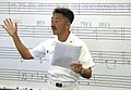 "US Navy 030627-N-3228G-002 Senior Chief Musician Tony M. Suazo, leading chief petty officer for the Pacific Fleet Band (PACFLT), instructs his musicians at an ""all hands"" rehearsal before performing at a local high.jpg"