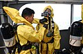 US Navy 040117-N-0331L-023 Nuclear, Biological, and Chemical (NBC) disposal technicians from the 1st Marines 1st Battalion prepare to search the Military Sealift Command (MSC) combat stores ship USNS Saturn (T-AFS 10).jpg