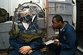 US Navy 040128-N-8955H-003 Damage Controlman 3rd Class James Allen from Oakland, Calif., conducts a MCU-2P Gas Mask fit test using a TDA 99M respirator functional testing system on Disbursing Clerk Seaman Recruit Aidan Lee.jpg