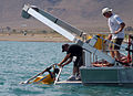 US Navy 040820-N-7136R-006 Steve Nicosa and Travis Brennan help pull a Remotely Operated Vehicle (ROV) out of the water after conducting a dive in Pyramid Lake.jpg