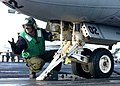 US Navy 041102-N-5345W-075 A Sailor assigned to V-2 Division guides the launch bar into the catapult shuttle for an S-3B Viking.jpg