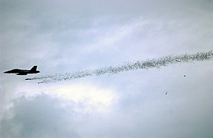 Airborne leaflet propaganda - A US Navy F/A-18 drops a leaflet bomb during a training exercise (2005).