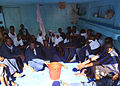 US Navy 050430-N-5526M-044 Rescued men and women sit together after their boat, a fishing vessel, capsized 25 miles off the coast of Somalia.jpg