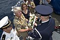 US Navy 050511-N-7293M-149 U.S. Air Force Senior Airman Robert Hoffman, assigned to the Andersen Air Force Base Blue Knights Honor Guard presents a memorial wreath to Mr. and Mrs. Bill Willis during a special memorial service.jpg