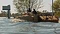 US Navy 050910-M-5901F-005 U.S. Marines aboard an amphibious assault vehicle (AAV) search the areas around the Chalmette Bridge for survivors of Hurricane Katrina.jpg