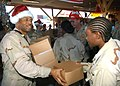 US Navy 061210-N-1328C-091 U.S. Navy Senior Chief Yeoman Shawn Newcoste, left, hands out Christmas gifts to junior enlisted U.S. service members assigned to Combined Joint Task Force - Horn of Africa at Camp Lemonier.jpg