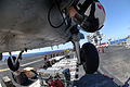 US Navy 070406-N-5961C-007 Aviation Warfare Systems Operator 2nd Class Anthony Chavez directs the SH-60 in closer to pick up a load of munitions aboard the Nimitz-class aircraft carrier USS Ronald Reagan (CVN 76).jpg