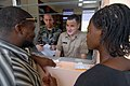 US Navy 070905-N-8704K-122 U.S. Air Force Capt. Brian Sydnor and U.S. Navy Lt. Cmdr. Chris Lynch, both attached to Military Sealift Command hospital ship USNS Comfort (T-AH 20), explain a prescription to a patient with help fro.jpg
