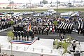 US Navy 071109-N-1825E-001 Sailors stationed at Naval Station Rota stand at attention during the colors presentation of the Grand Opening of their new Navy Exchange and DeCA Commissary Nov. 9.jpg