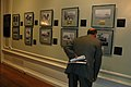 US Navy 071114-N-4245W-029 A guest looks at an exhibit of photos at the grand opening of the Great White Fleet Centennial Exhibit.jpg