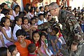 US Navy 071215-N-7286M-010 U.S. Air Force Chaplain, Maj. Philip G. Houser meets with the children at MEIN College.jpg