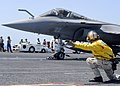 US Navy 080720-N-7571S-011 Lt. Cmdr. Christopher Biggs shoots a French F-2 Rafale off the aircraft carrier USS Theodore Roosevelt (CVN 71) during combined French and American carrier qualifications.jpg