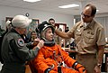 US Navy 081209-N-1825E-020 NASA training team member Lt. Col. Melinda Screws shows students how to adjust a space suit helmet a training class for the Space Shuttle Transoceanic Abort Landing Site Program.jpg