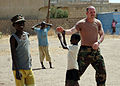 US Navy 090207-N-1655H-287 A service member from the U.S. Embassy in Dakar, Senegal, gives a high-five to a Senegalese boy while playing soccer at the Vivre Ensemble orphanage after a team of Africa Partnership Station 2009 mem.jpg