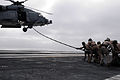 US Navy 090319-N-7730P-154 Members of Explosive Ordnanace Disposal Mobile Unit 11, Platoon 0-2 extend a fast-rope.jpg