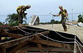 US Navy 090421-N-7948C-054 Construction Electrician 2nd Class Darius Michael, left, and Builder 2nd Class Patrick Tansey pull out nails from the roof of Balise Elementary School in Port Gentil.jpg