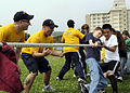 US Navy 090609-N-7478G-111 Information Systems Technician 1st Class Nicholas Delgado Information Systems Technician 1st Class Nicholas Karp cheer on the students from Yokosuka Middle School during a game of tug-of-war.jpg