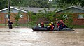 US Navy 100501-N-0000X-004 Rescue personnel navigate flooded streets in a family housing section of Naval Support Activity Mid-South Saturday, May 1, 2010 during major flooding after heavy rains breeched nearby protective levee.jpg
